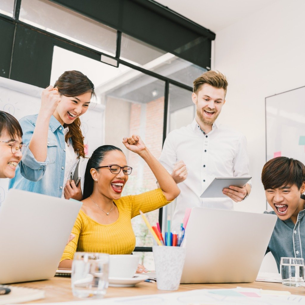 multiethnic-diverse-group-of-coworkers-celebrate-together-with-laptop-picture-id665647220